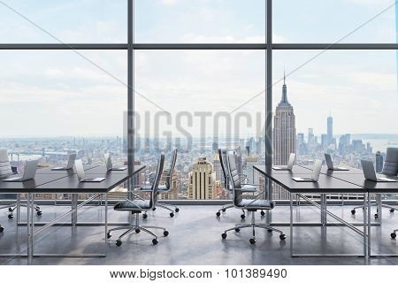 Workplaces In A Modern Panoramic Office, New York City View From The Windows. Open Space. Black Tabl