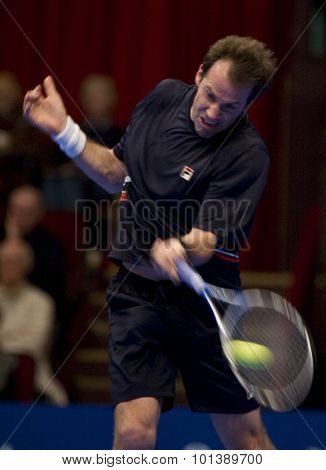 LONDON, ENGLAND. 05 DECEMBER 2009 -   Greg Rusedski (GBR) competing in a preliminary match in the the season finale to the ATP Champions Tour match during the AEGON Masters Tennis