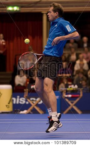 LONDON, ENGLAND. 06 DECEMBER 2009 -   Stefan Edberg (SWE) gets hit in the chest whilst competing in the singles final at the season finale to the ATP Champions Tour during the AEGON Masters Tennis