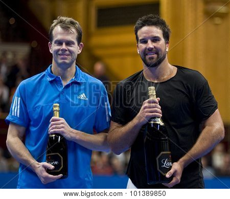 LONDON, ENGLAND. 06 DECEMBER 2009 -   Stefan Edberg (SWE) (L) and Pat Rafter (AUS)  with their magnums of champagne after competing in the singles final at the season finale to the ATP Champions Tour