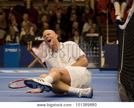 LONDON, ENGLAND. 05 DECEMBER 2009 -   Murphy Jensen (USA) hits the deck after getting a ball smashed into the midrift while competing in the season finale to the ATP Champions Tour match