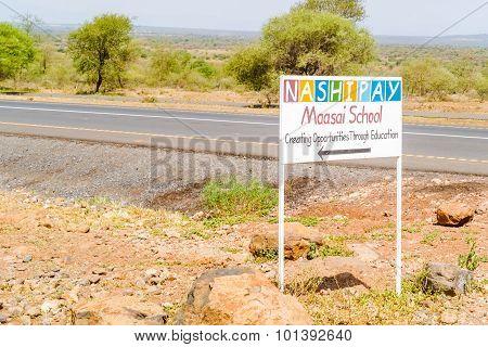 Maasai School Sign At The Road In Tanzania