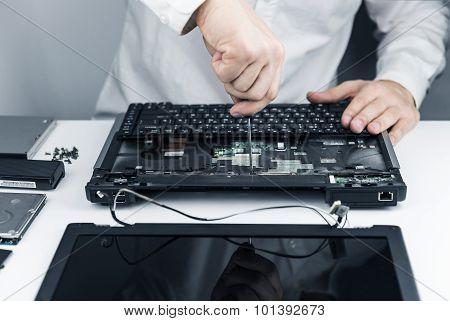 Man Repair Laptop