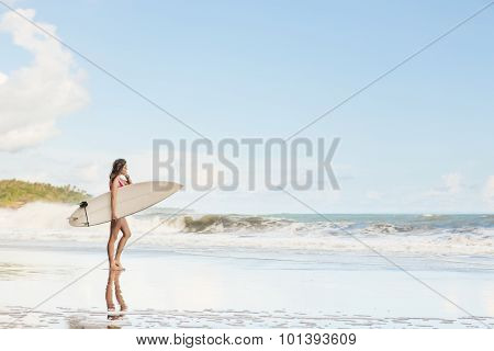 Beautiful Girl With Long Hair On The Beach With Surfboard