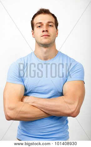 Bully or arrogance concept - muscular young guy looking tough