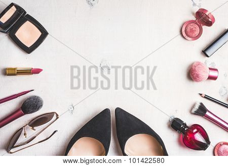 Feminine cosmetic background. Overhead of essentials of a modern woman. Cosmetic objects frame. Instagram filter style poster