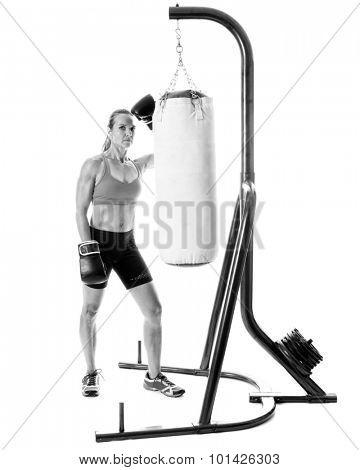 Heavy bag exercise. Studio shot over white.