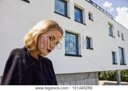 Beautiful Stylish Girl In A White Building