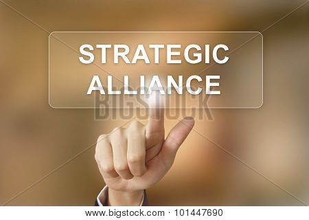 Business Hand Clicking Strategic Alliance Button On Blurred Background