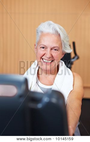 Happy Senior Woman In Gym