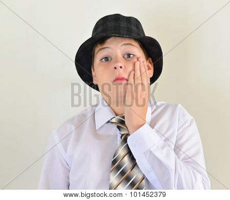 Portrait Of A Teenage Boy In  Hat And Tie