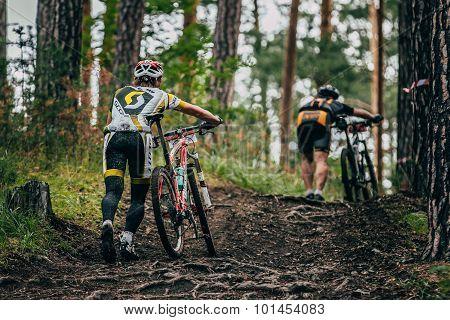 two mountainbiker in a uphill race