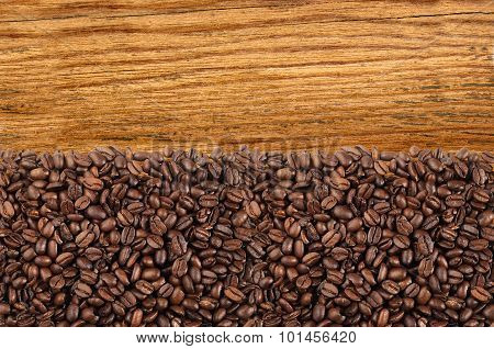 Close-up Of Roasted Coffee Beans Over Wooden Background