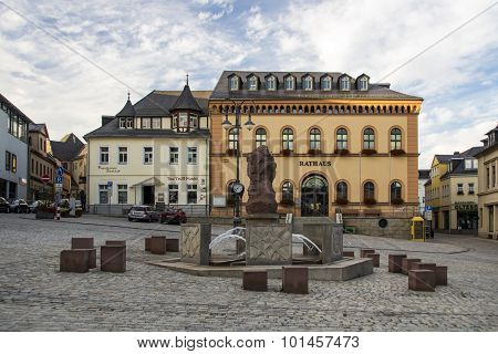 Reichenbach, Germany - August 27, 2015: Town hall a fountain and other bulidings at the market place of Riechenbach (Vogtland)
