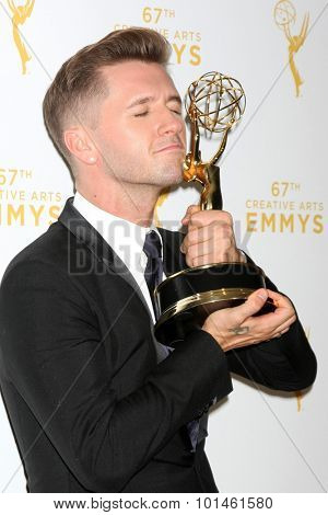 LOS ANGELES - SEP 12:  Travis Wall at the Primetime Creative Emmy Awards Press Room at the Microsoft Theater on September 12, 2015 in Los Angeles, CA