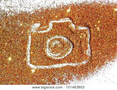 Blurry Photo Camera on golden and red glitter sparkle on white background