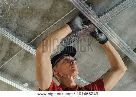 Man Assembles Profile Metal Frame