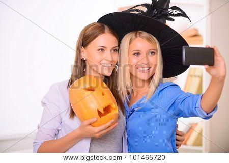 Happy girls making photos