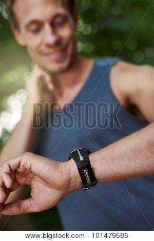 Man Looking At His Watch While Checking Pulse