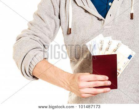 Tourist Holding Passport Full Of Money.