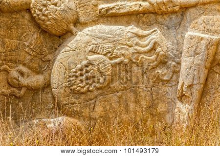 Ancient relief of the necropolis Naqsh-e Rustam that shows the detail on the horse saddle, near ruins of Persepolis. poster