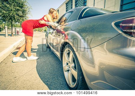 Man Picking Up A Beautiful Girl With His Sport Car