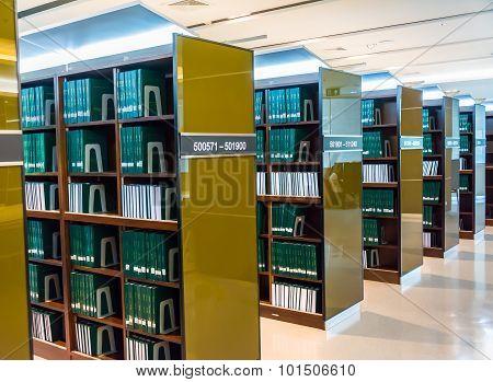 BANGKOK, THAILAND - 10 SEPTEMBER : Row of thesis bookshelves in library of Chulalongkorn University