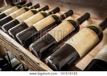 Old wine bottles on the wine shelf.