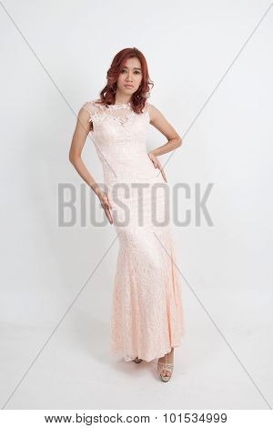 Portrait Of A Beautiful Girl In A Light Pink Dress Isolated On Overwhite Background