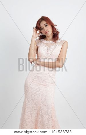 Half Portrait Of A Beautiful Girl In A Light Pink Dress Isolated On Overwhite Background