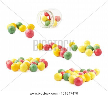 Chewing gum balls and glass jar composition, isolated over the white background poster