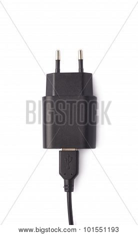 Fragment of the black adapter charger isolated