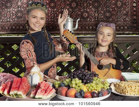Two Little Girls Playing Mandolin And Dancing