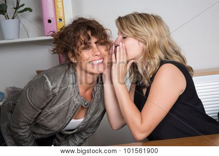 Two Friend Girls Whispering A Secret - Young Women Sharing Gossip And Whispering Secrets