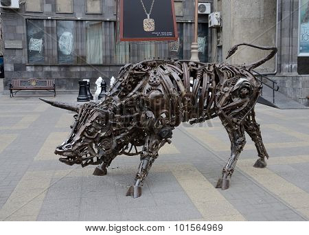 Bull art statue made from old iron mechanisms in old city center in Yerevan, Armenia