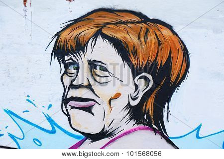 Hannover, Germany - September 10, 2015: A graffiti of German chancellor Angela Merkel by an unknown street artist.