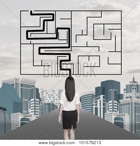 Businesslady with labyrinth