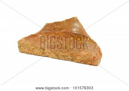 Archeological sherd fragment of ancient pottery isolated on a white background