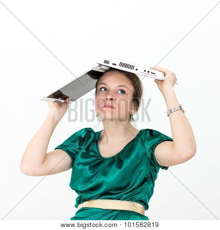Helpless young woman posing with a laptop on white background poster