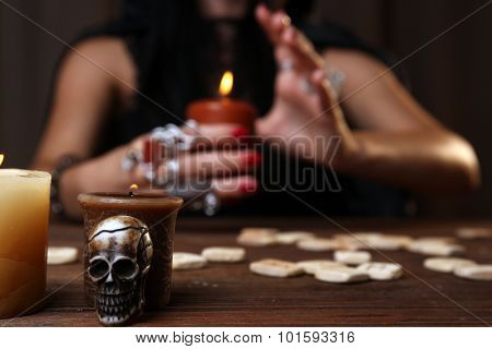 Witch - fortune teller on dark background poster
