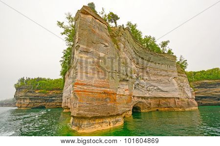 Jagged Rock On A Colorful Lakeshore