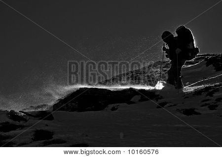 The tourist on a hillside in snowstorm