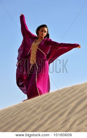 Beautiful Brunette Woman In Arabic Desert