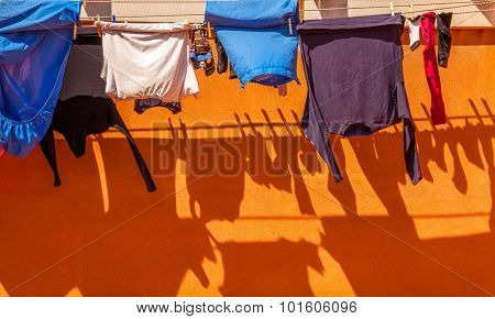 Clothes on rope dry after wash with shadow
