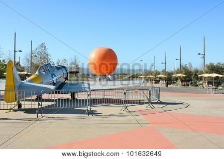 IRVINE, CA - FEBRUARY 10, 2015: Vintage airplane at the Orange County Great Park with Balloon Ride in the Background. The aircraft is a WWII SNJ-5 Texan.