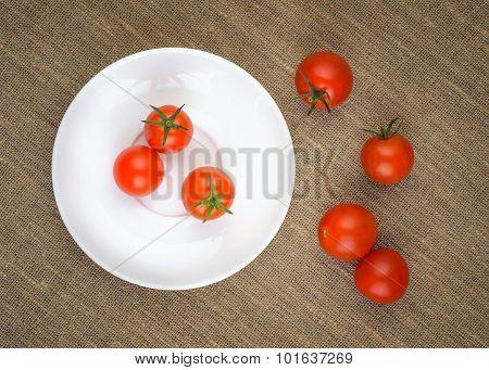 Ripe Fresh Cherry Tomatoes On White Plate