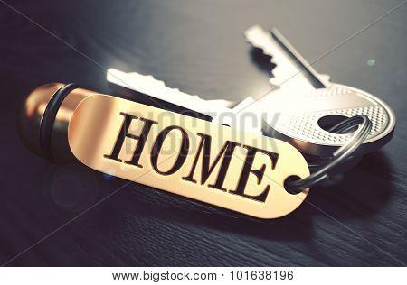 Home written on Golden Keyring.