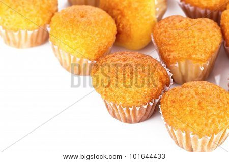 Delicious Mini Muffins On A White Background