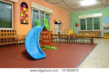 Large Game Room In A Nursery With The Plastic Slide For Children