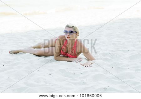 The Beautiful Woman In Orange Bikin Lies On Sand